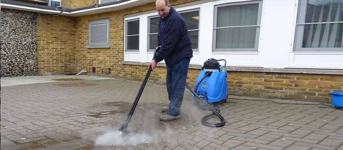 effective cleaning of dirt and debris from outdoor coutyards, is achieved with high temperature steam vapour