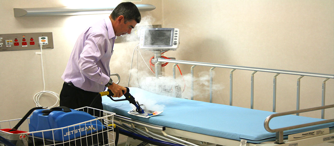 sanitizing and decontaminating bedding in clinic treatment rooms