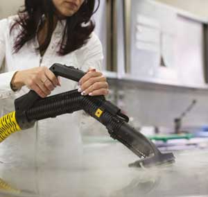 Degreasing a commercial kitchen with steam vacuum cleaner