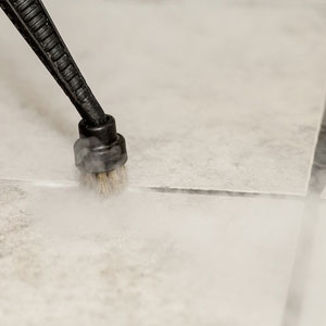 sanitiza and remove stains and mould from grout lines with professional dry stem vapour cleaning equipment