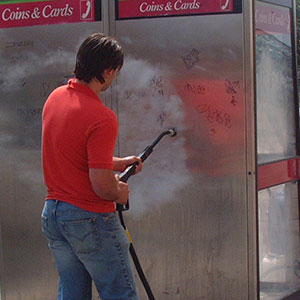 using high powered steam vapour cleaning equipment to remove graffiti