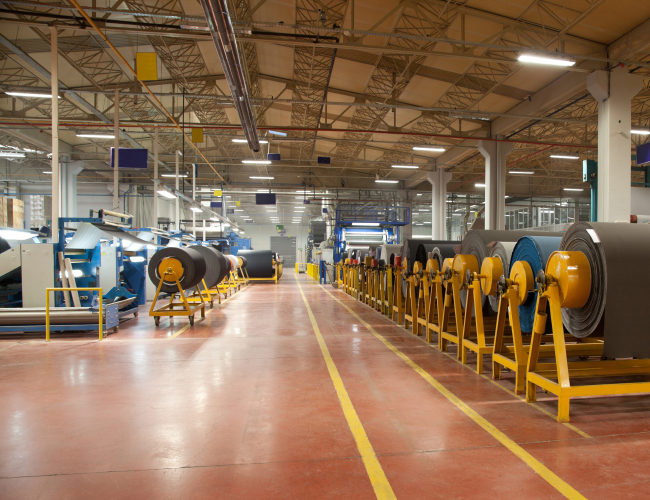 clean manufacturing flooring areas with vacuum floor machine