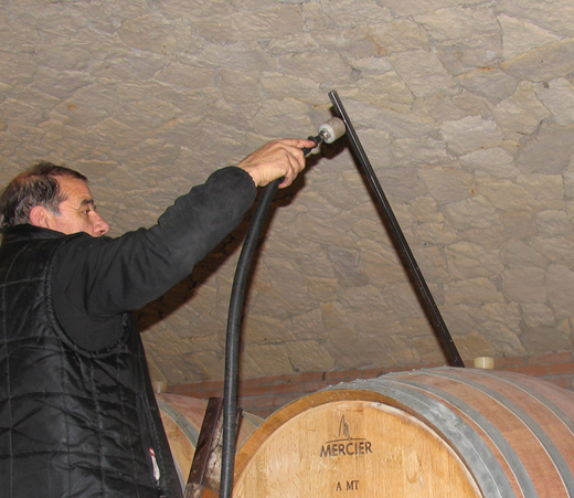 steam diffuser is placed within a wine barrel to sanitise internal surfaces and remove brettanomyces