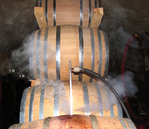 powerful pressurised steam is vapourising within an oak wine barrel, removing all tartrates and conntaminants